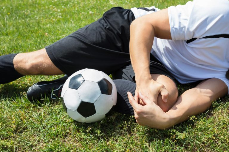 Football player with injured knee