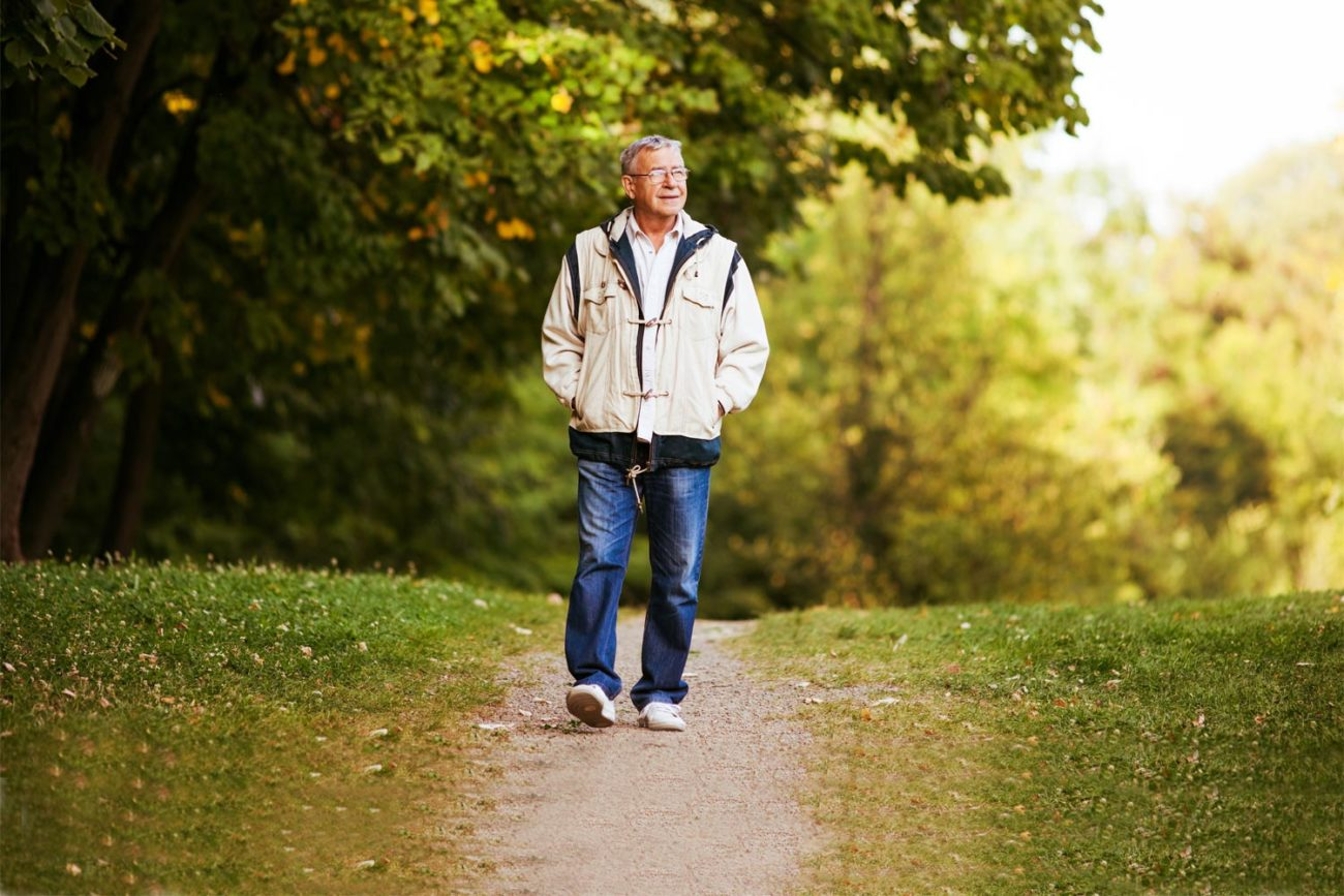 elderly man out walking in the park