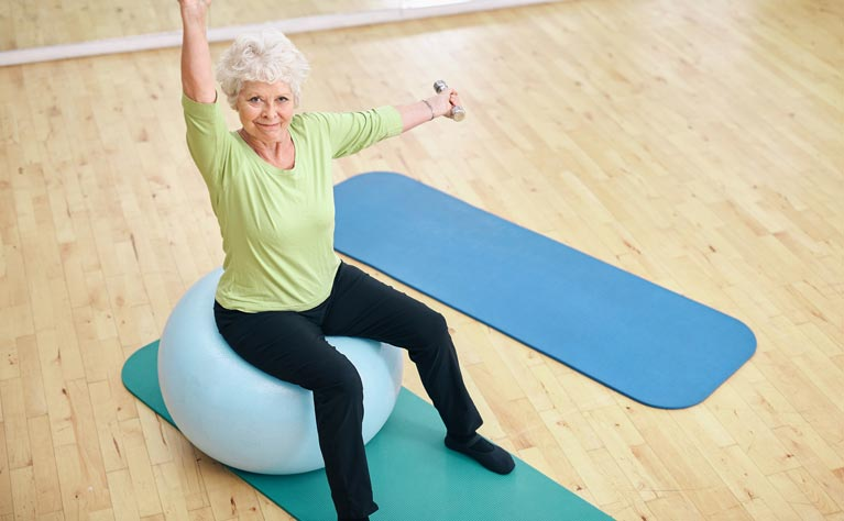 Senior woman doing pilates