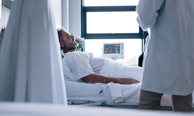 man-in-hospital-bed