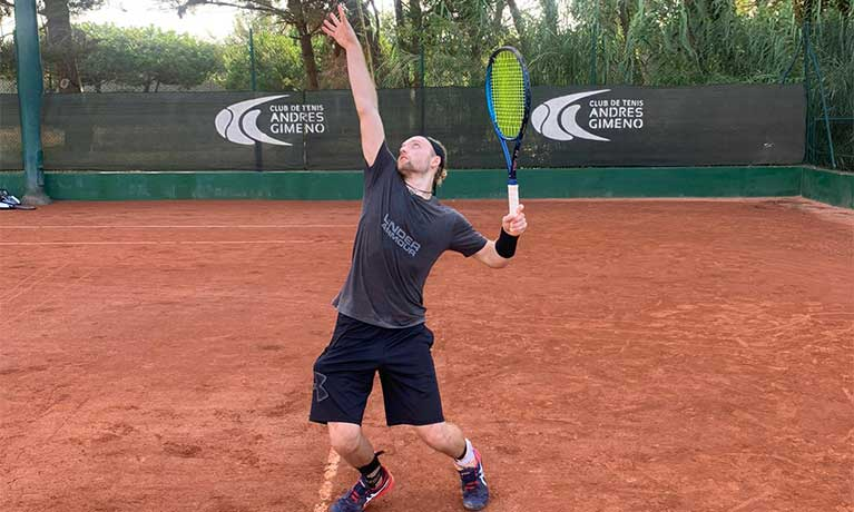 Man serving playing tennis