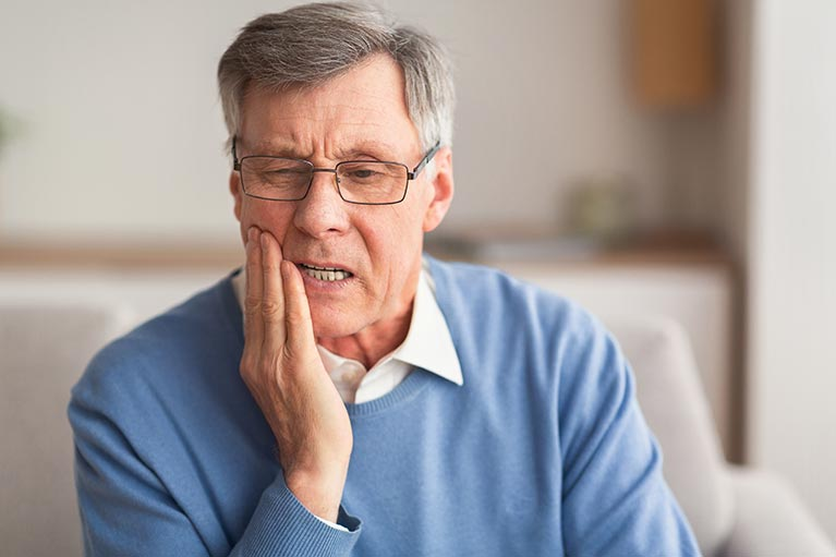 Man with jaw ache