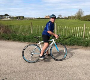 Chris out for a bike ride following his operation