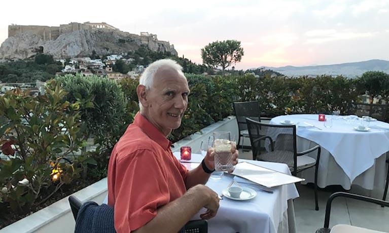 Deerek enjoying a drink outside in a restaurant